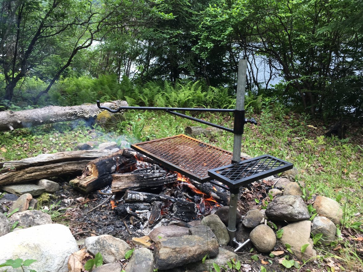 Adjustable And Portable Campfire Barbecue Grill.